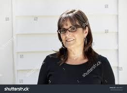 attractive middle aged women dark hair attractive middle aged woman brown hair stock photo 638874877