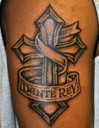 brilliant cross and dante rey banner tattoo design on shoulder31