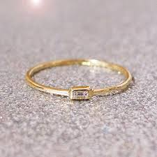 horizontal emerald cut engagement ring we are in with this horizontal engagement ring trend
