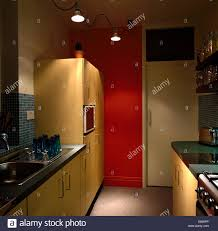 track lighting in the kitchen red painted kitchen cabinet with brown tile backsplash and ceiling