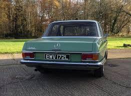 green mercedes benz 1973 mercedes benz w114 280 being auctioned at barons auctions