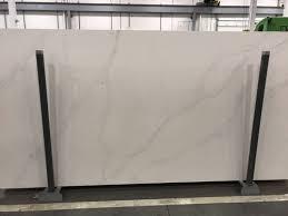 best granite for white dove cabinets white dove cabinets and calacatta gold quartz combo