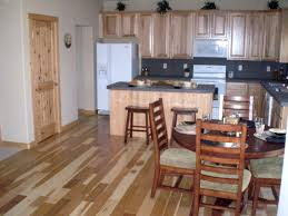 rustic hickory cabinets with black appliances u2014 the clayton design