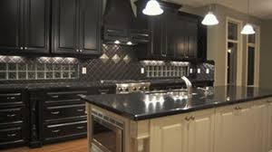 How To Paint Cabinets To Look Distressed Distressed Wood Kitchen Cabinets Kitchen Island With Breakfast Bar