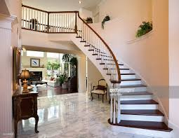 white grand foyer staircase marble floor showcase home interior