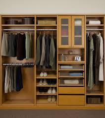 man closets organizer with glass storage door and drawers plus