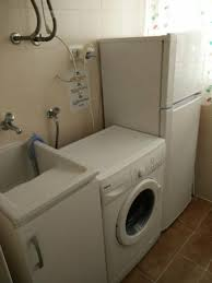 washing machine with sink utility room with full size fridge washing machine and sink