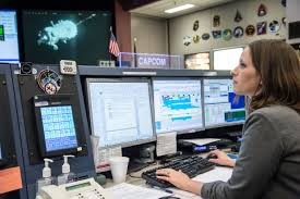 spacecraft communicator christie bertels monitors soyuz docking nasa