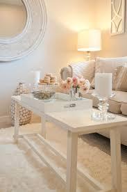 living room gray sofa white futons gray rug white pendant lights