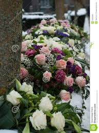 cemetery flower arrangements funeral flowers arrangement in the snowon a cemetery stock photo