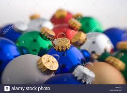 colorful tree bulb ornaments piled together on white
