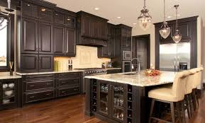 dark brown wooden kitchen island combined with storage with glass