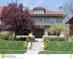 craftsman style home on hill with landscaping stock photo image