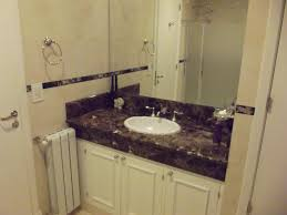 modren white bathroom cabinets with dark countertops beautiful