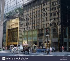 horse drawn carriage in front of trump tower entrance new york