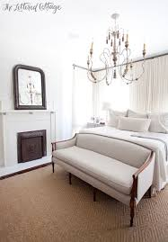 bedroom loveseat master bedroom white and neutrals fireplace chandelier