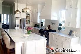tower cabinets in kitchen light and bright open concept kitchen with a large island hood and