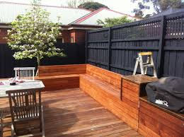 deck seating black fence in built bbq magnolia tree decks