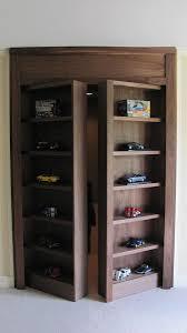 custom display case with secret doorway to hidden room by natural
