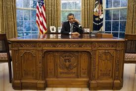 obama at desk behind the desk with president obama invisible children