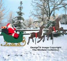 wooden yard santa in sleigh with reindeer 3d www