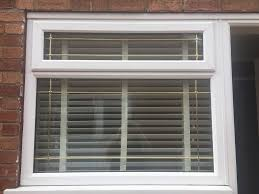 upvc window and frame with fitted wooden blinds in formby