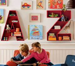 great looking alphabet shaped bookshelves with beautiful wall