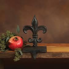 cast iron brown fleur de lys stocking holder by homart seven
