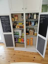 high white wooden pantry cabinet with shelves also double black