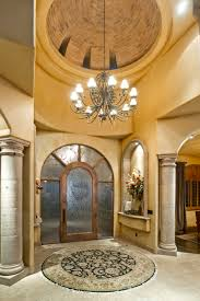 two story dome cieling with cantera stone pillars at entryway of