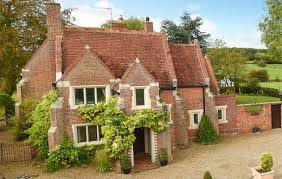 a tudor style house with character and land within easy reach of