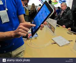 paris france man holding ipad tablet in hands