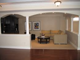 L Shaped Wooden Sofas Interior Basement Finishing With Stone Fireplace And Pretty Large