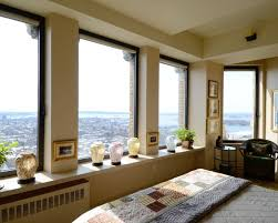 appealing day view of the city from the cozy bedroom area with
