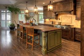 kitchen ideas with island green wooden kitchen island with simple ladder back chairs