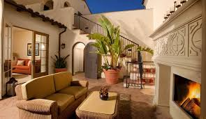mediterranean patio with spanish tile roof by charles roe zillow