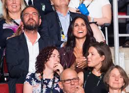 meghan markle looks on from crowd as prince harry opens invictus
