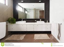 New Bathroom by Double Basin Vanity And Mirror In Contemporary New Bathroom Stock