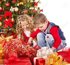 children with gift box near christmas tree isolated stock photo