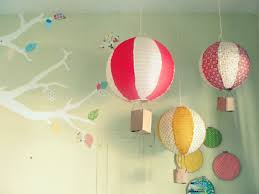 handmade air balloons hanging from the ceiling what an