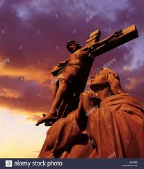 statue of jesus on cross at sunset stock photo 1380538 alamy
