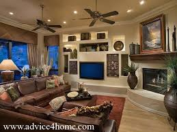 how decorate a living room with brown sofa brown sofa design and cream wall with shelves in living room on