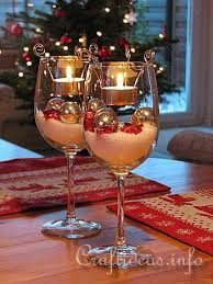 ornament and tealight filled wine glasses