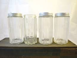vintage 4 hoosier cabinet spice jars ribbed depression glass clear vintage 4 hoosier cabinet spice jars ribbed depression glass clear molded glass antique kitchen spice jars metal shaker tops set of four