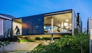 lush brazilian lens house treats a neighboring mountain as an