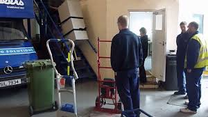 demonstration of electric sack truck stair climber at bradbeers
