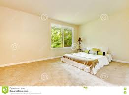 empty bright bedroom with small bed and lamp stock photo image