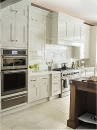 using high gloss paint on kitchen cabinets transitional kitchen cabinets polished nickel hardware