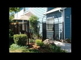 ornamental iron fence and iron gates