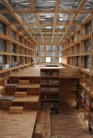 contemporary library design for home with shelving light fixtures